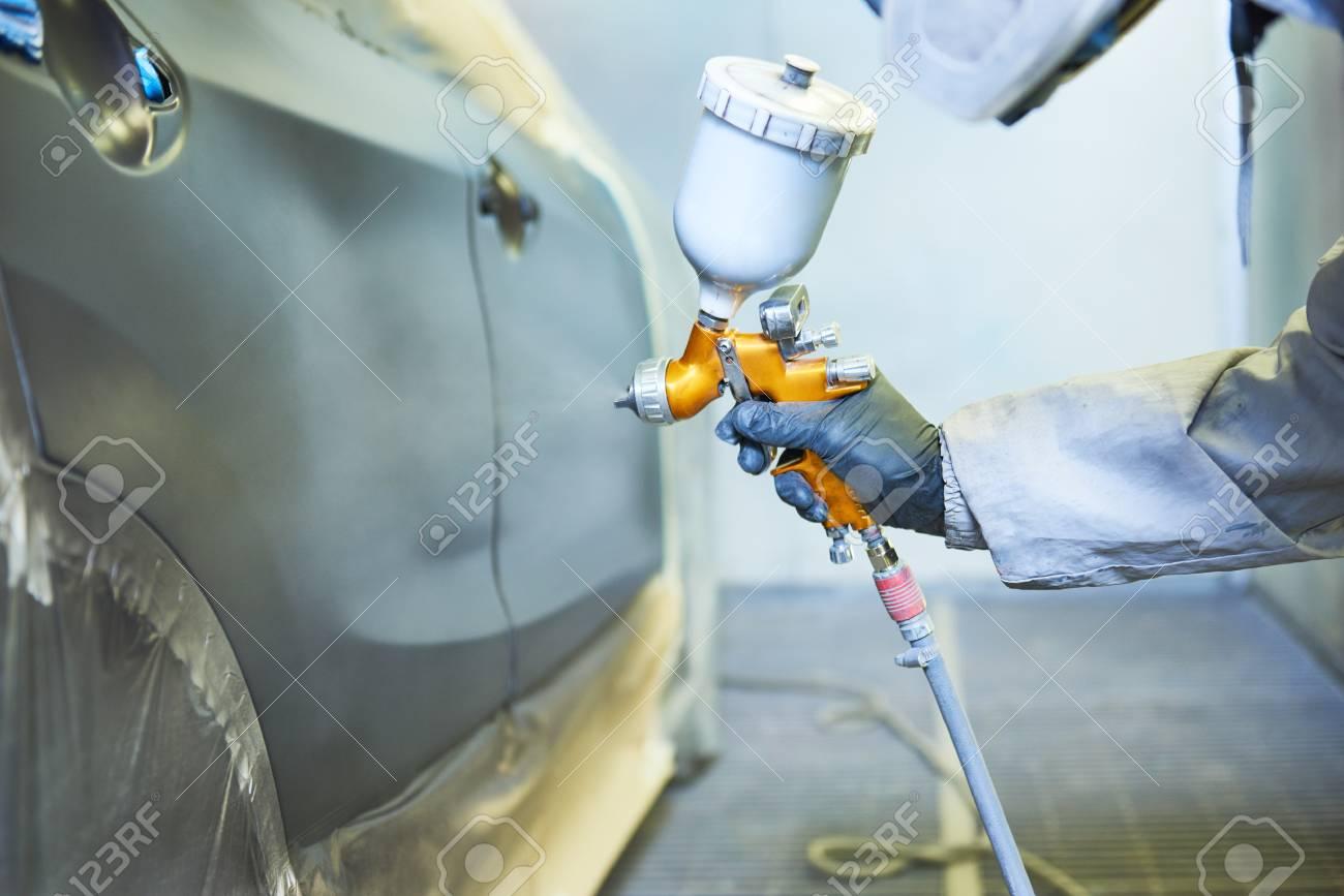 repairman painter in chamber painting automobile car bonnet - 93307050