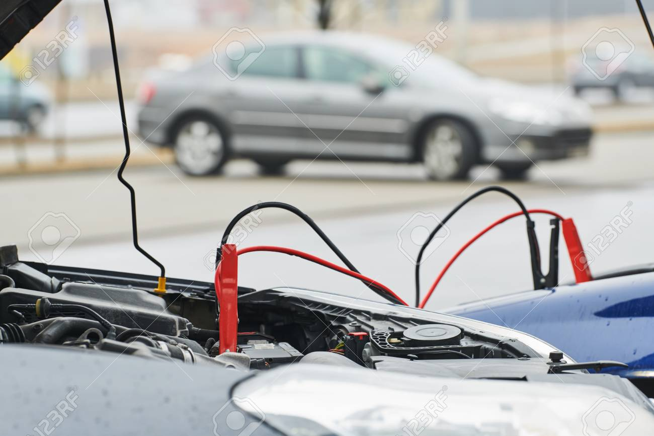 Automobile Help. Booster Jumper Cables Charging Automobile ...