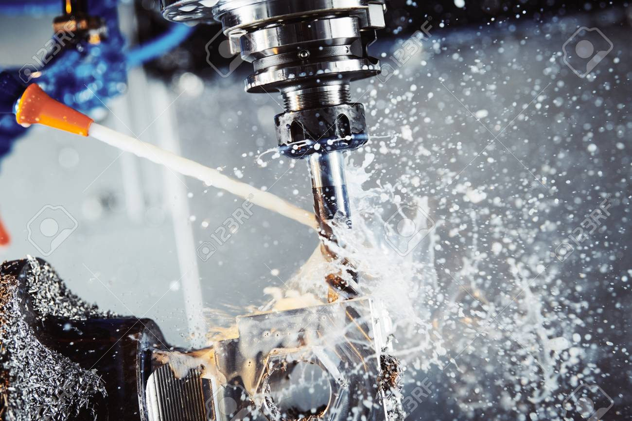 Milling metalworking process. Industrial CNC metal machining by vertical mill. Coolant and lubrication - 103905931