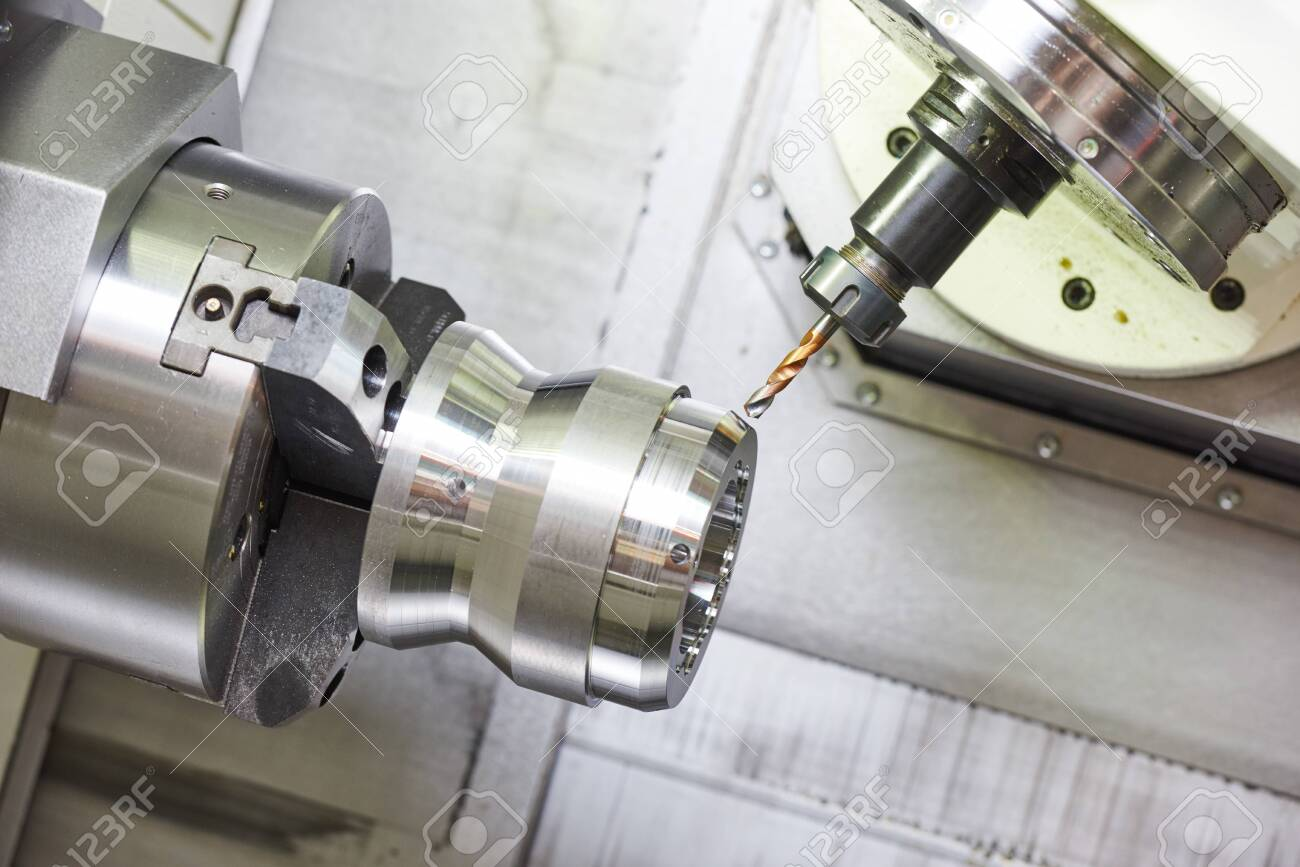 metalworking industry. drilling a hole on modern metal working machining center - 139333371