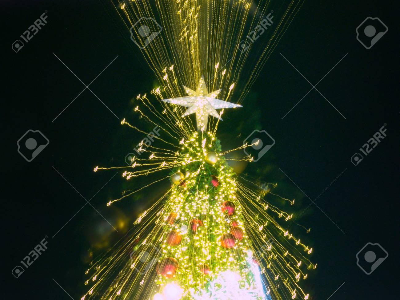 Light Of Christmas.Zoom Burst Light Of Artificial Pine Christmas Tree With Star