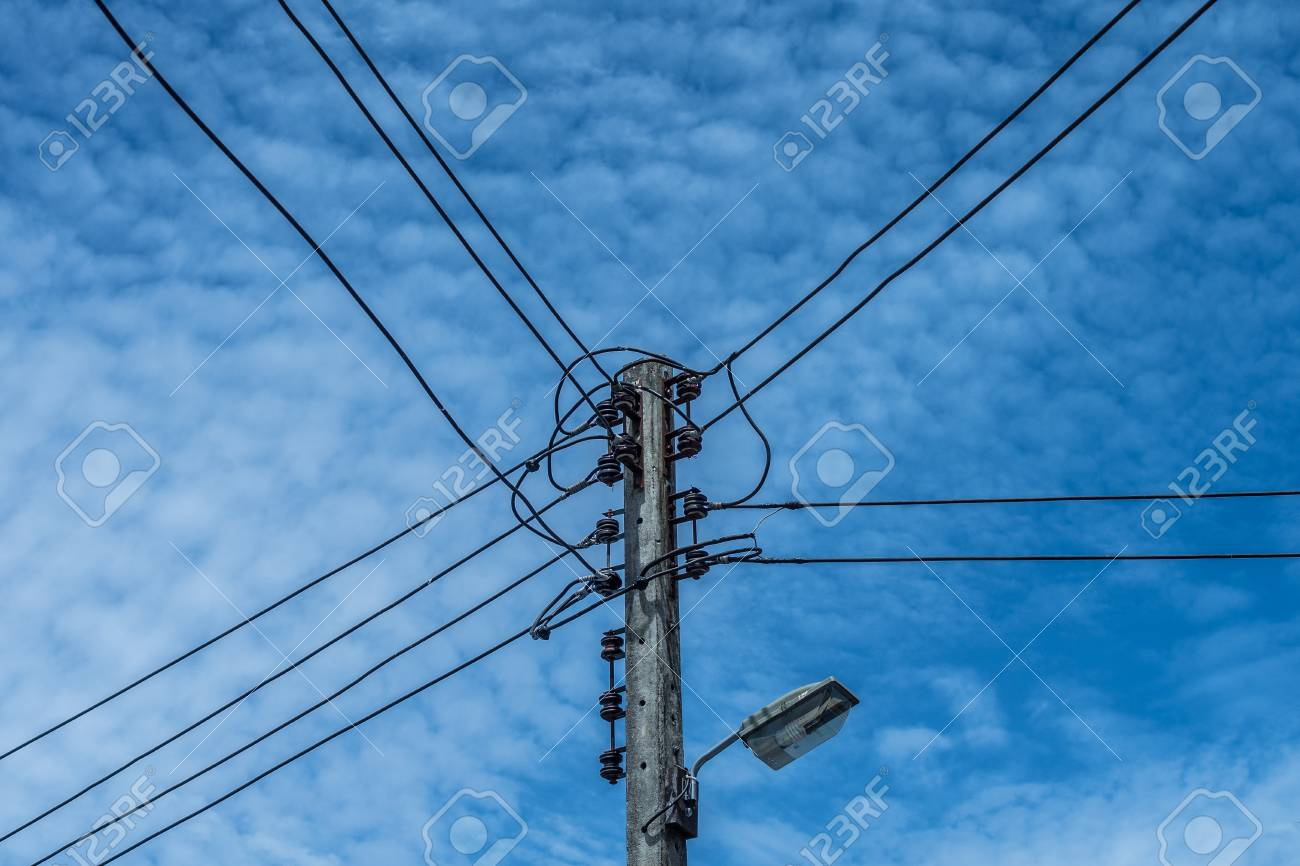 electric wire and lamp on electrical pole with blue cloudy sky background  stock photo - 107323263