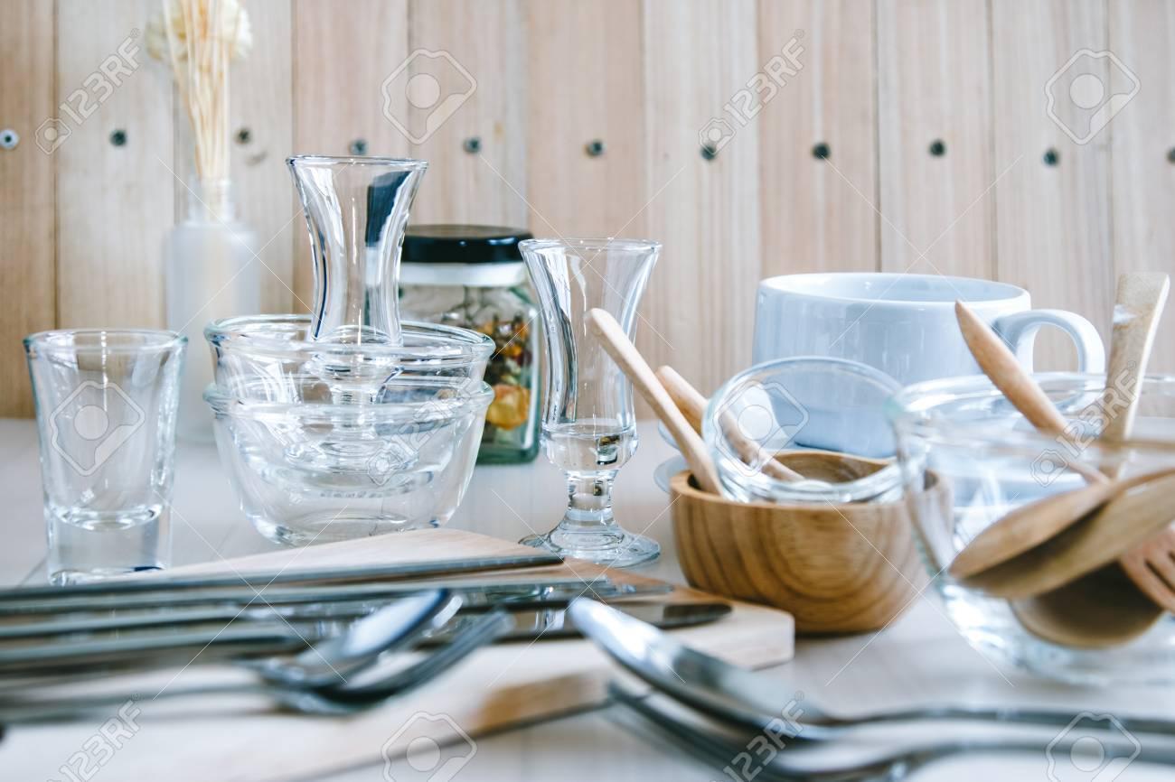 Set Of Kitchen Ware On Table, Kitchen Utensils. Glass Bowl, Wooden ...