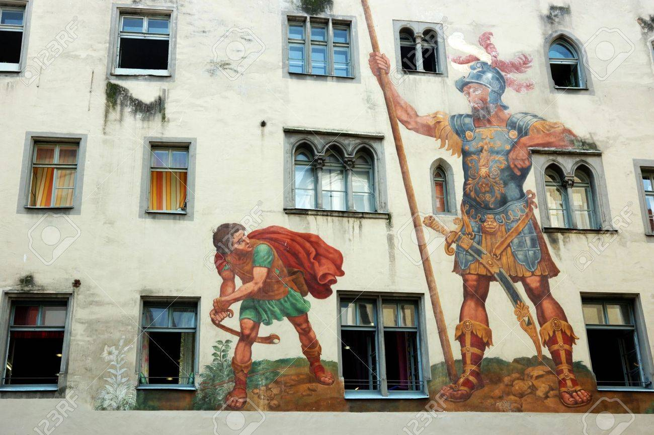 david and goliath on the house wall regensburg unesco heritage
