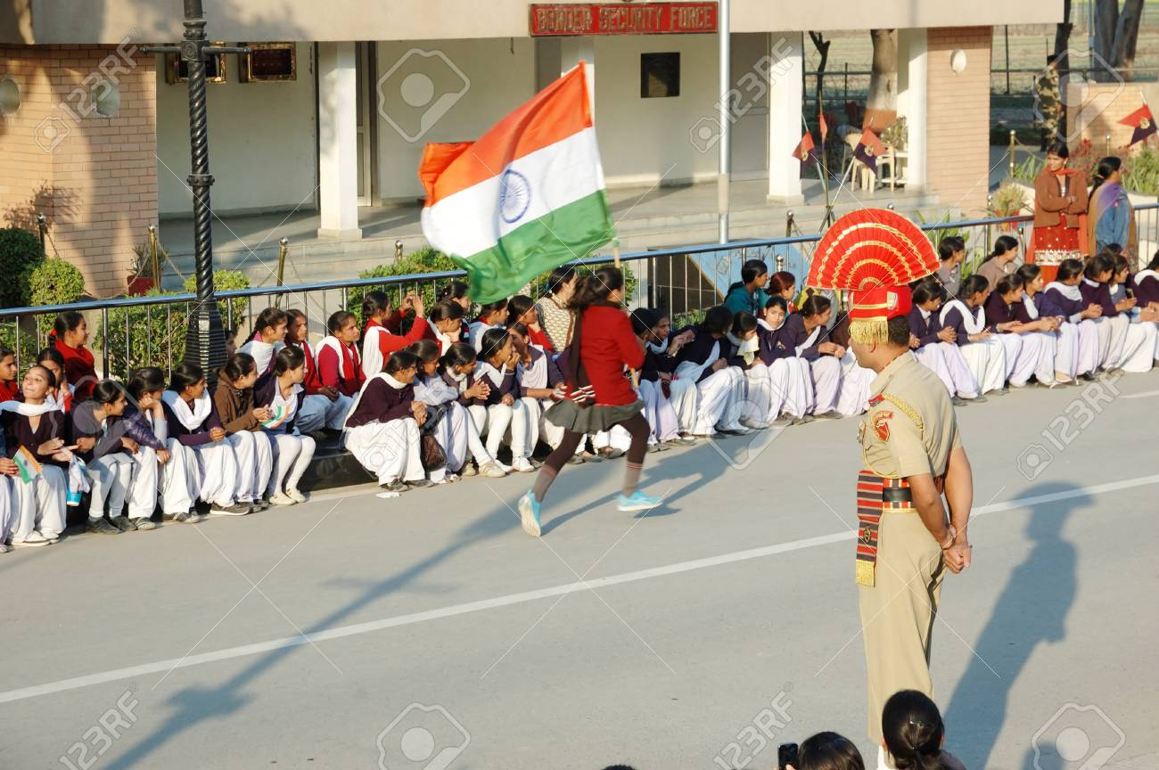 Attari,Punjab,India,December 7,2012 - Indian people celebrating at the Indian - Pakistani border during daily border closing ceremony  Stock Photo - 17949422