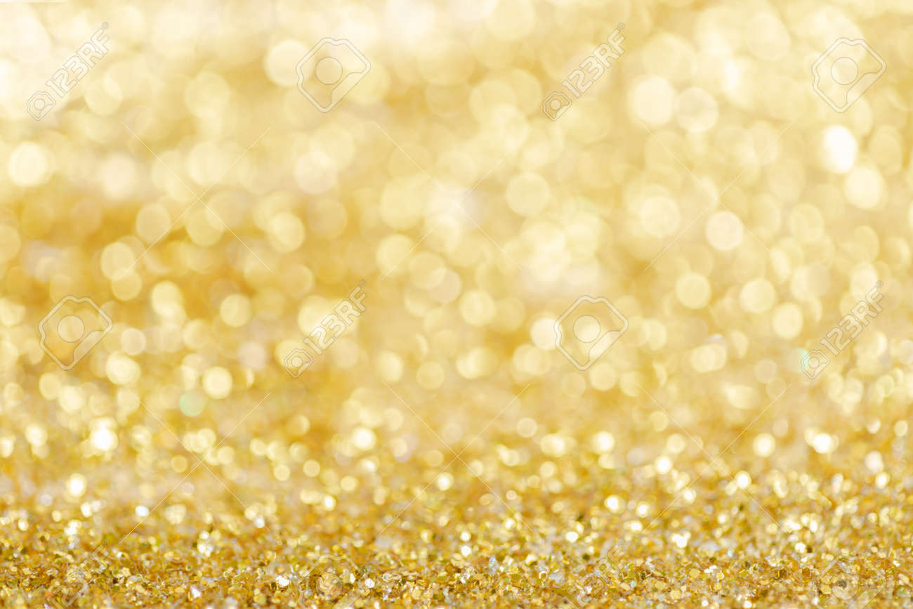 Gold light Festive Christmas background. Abstract twinkled bright background with bokeh defocused golden lights - 157957338