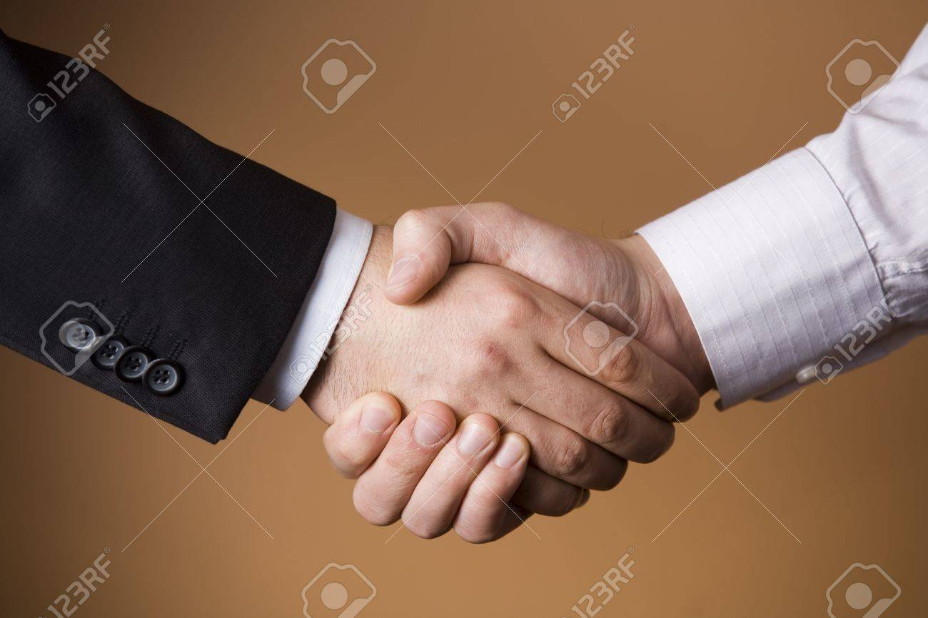 Two Businessmen shaking hands - Deal - Finance - Business - Agreement - 8900962