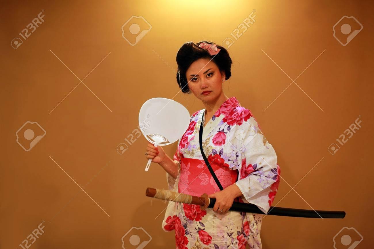 Japanese geisha samurai with sword on orange background - 23857433