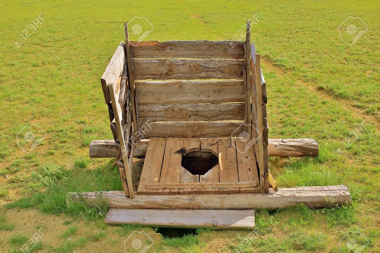Mongolian wooden squat toilet outside yurt, grassland of mongolia - 23485274