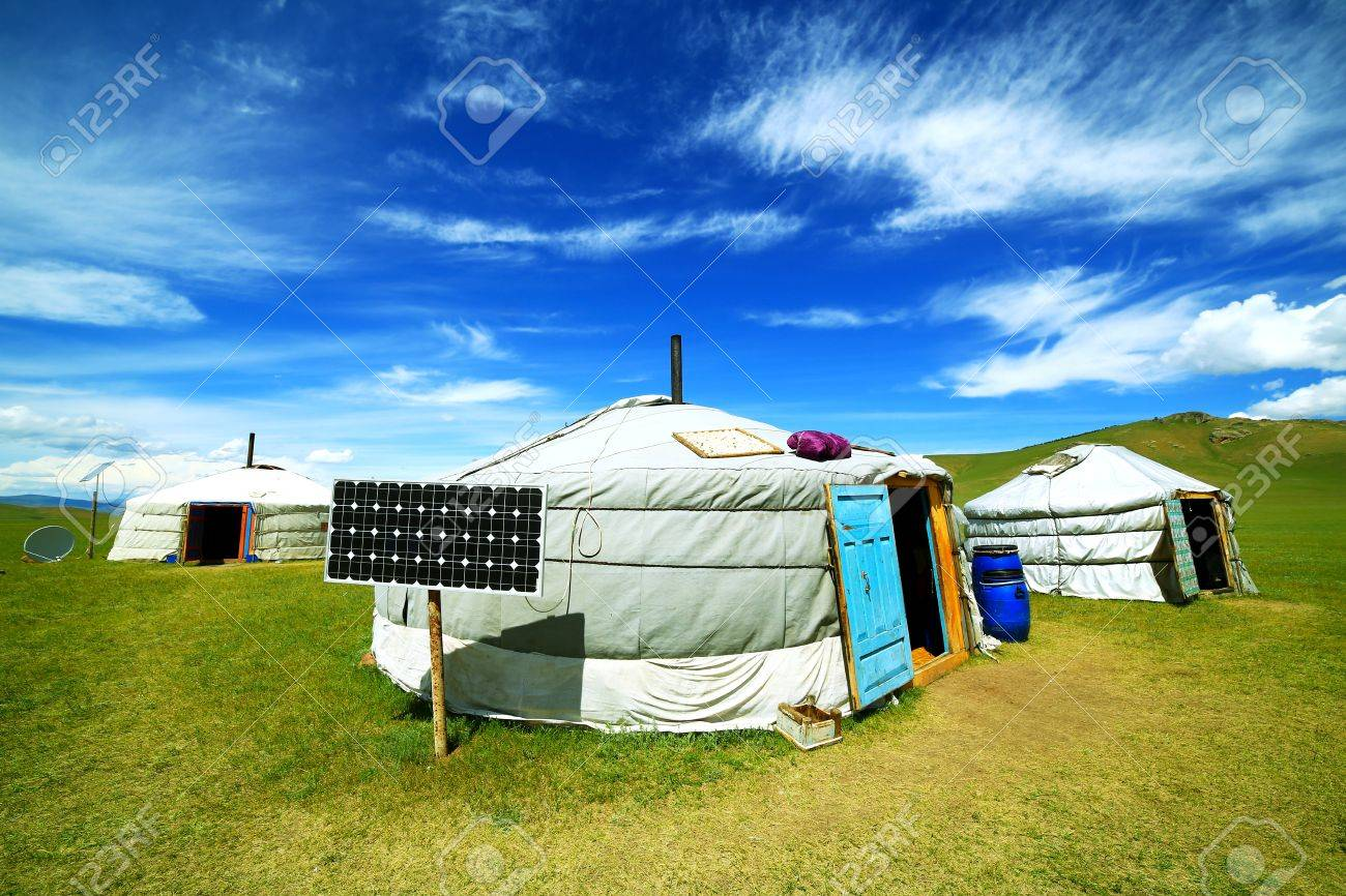 Mongolian ger camps with solar power, TV satellite and oxcart, Central Mongolia. Great contrast, modern and traditional lifestyle melting each other - 23485275