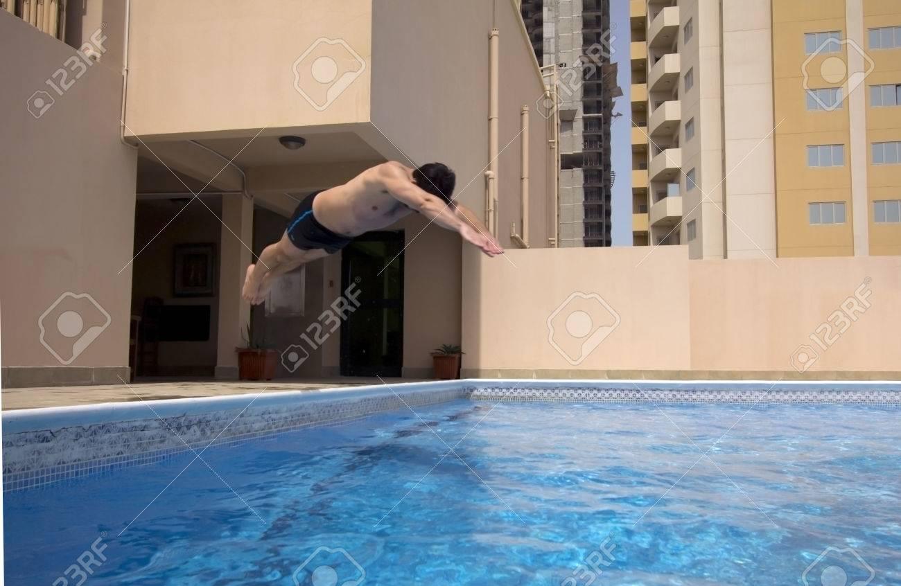 man swim in swimming pool at roof of apartment, bahrain - 25629275