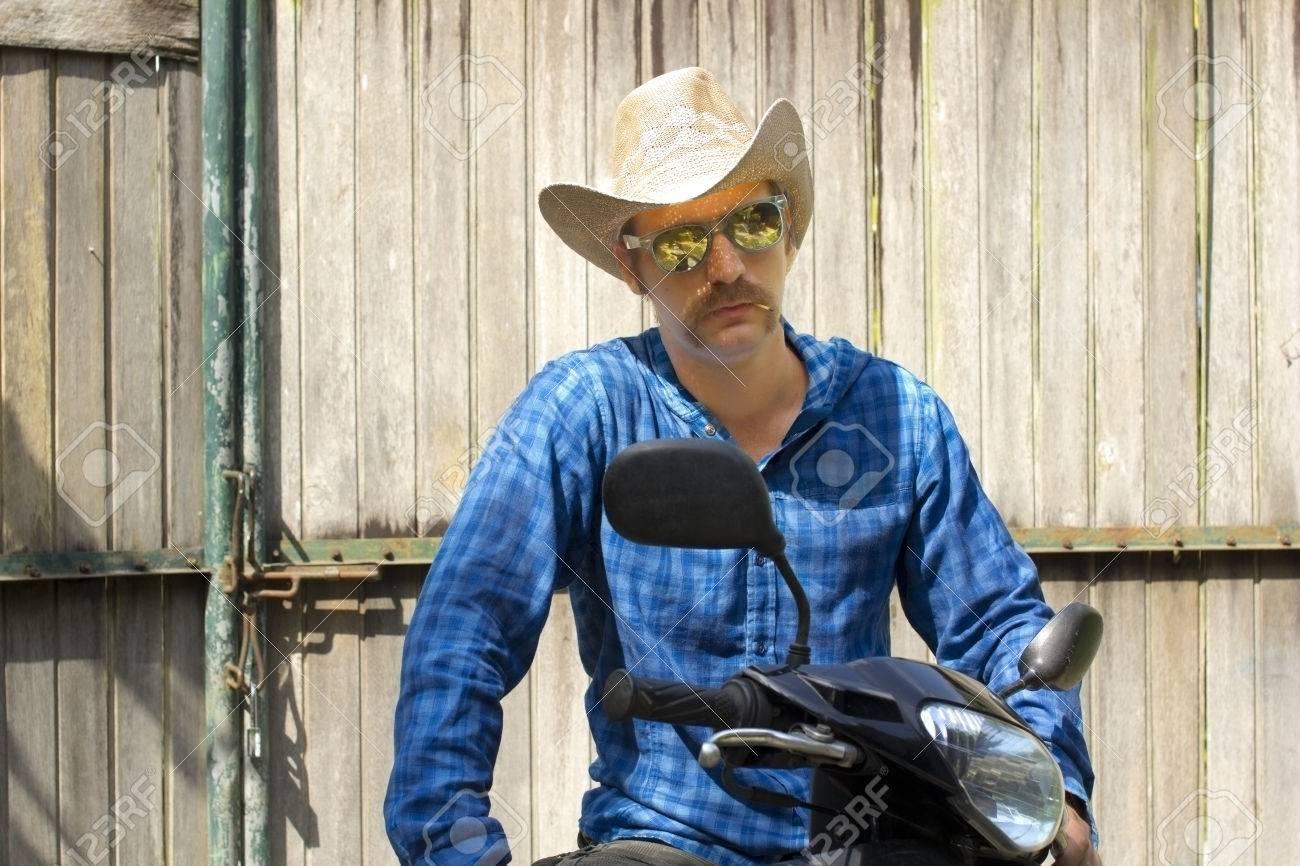 cowboy on motorbike - 23858340