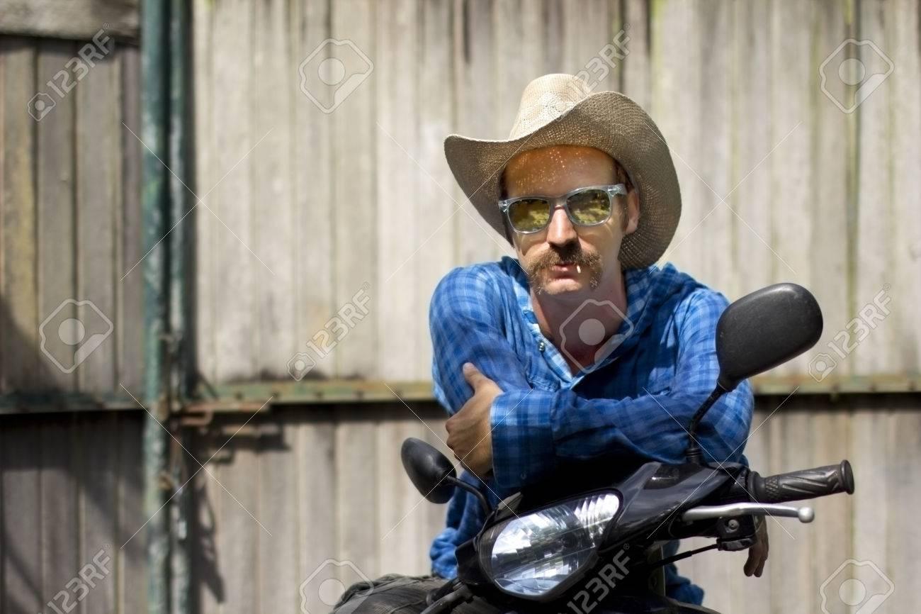 cowboy on motorbike - 23858344