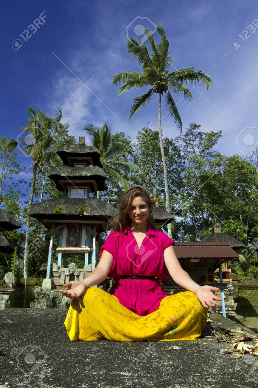 caucasian woman meditating yoga in balinese temple - 24053394