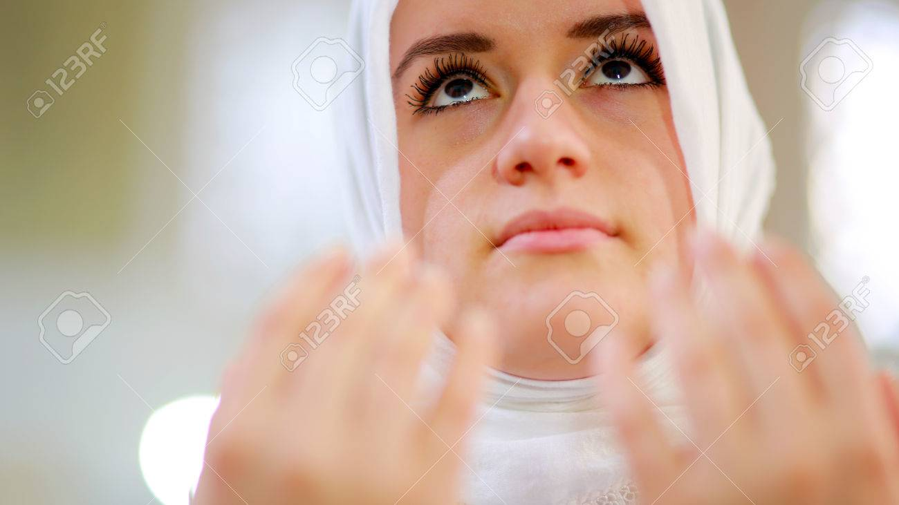 Muslim girl saying her everyday salat prayer in mosque - 23857902