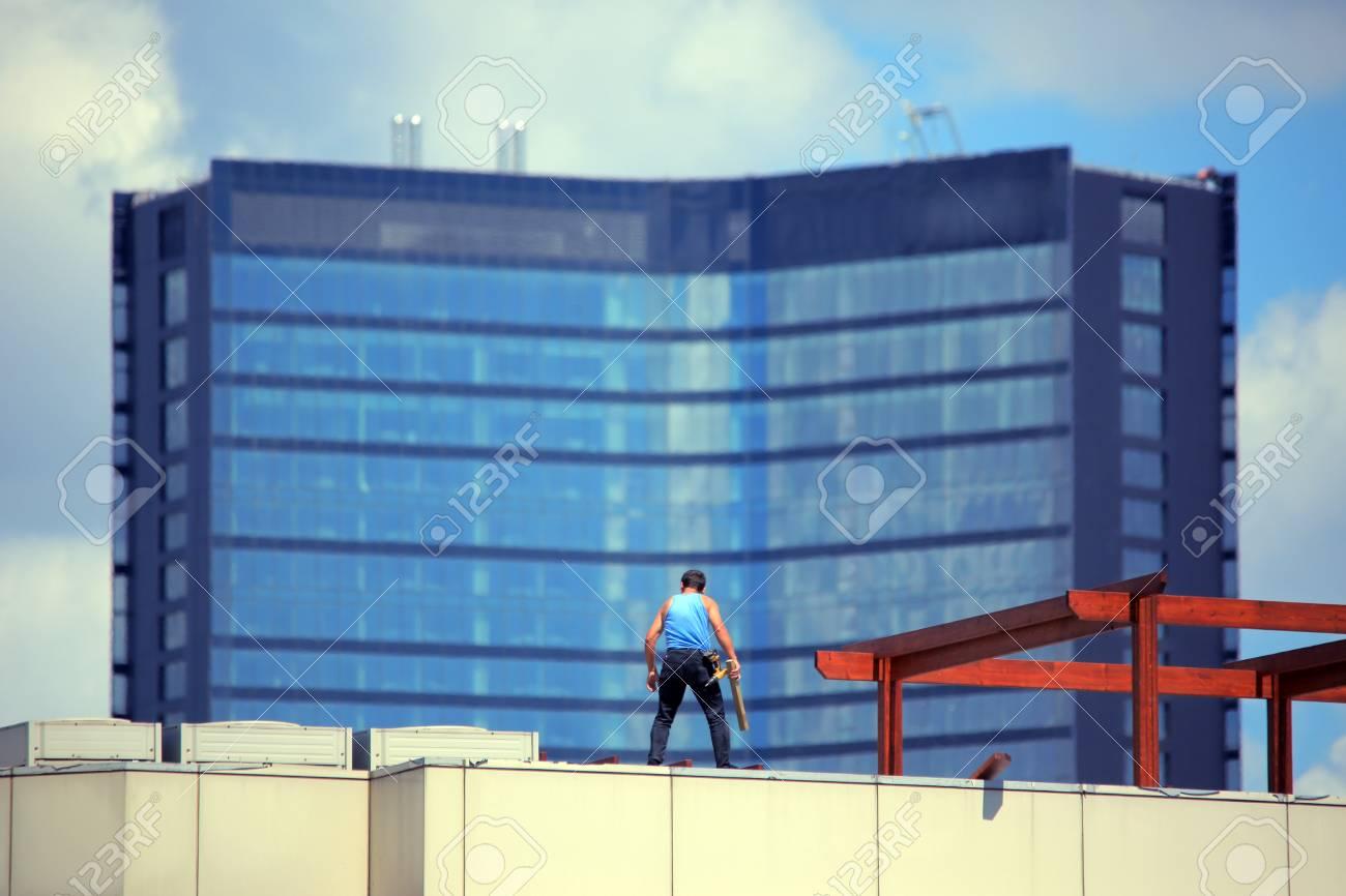 repairment worker at rooftop - 25629278