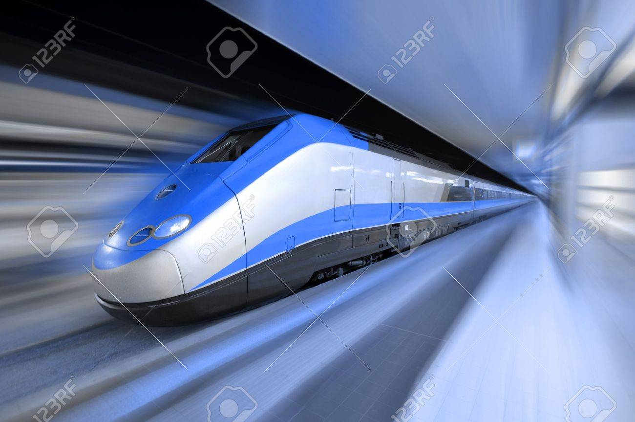 Fast train traveling at high speed through a station Stock Photo - 12460360