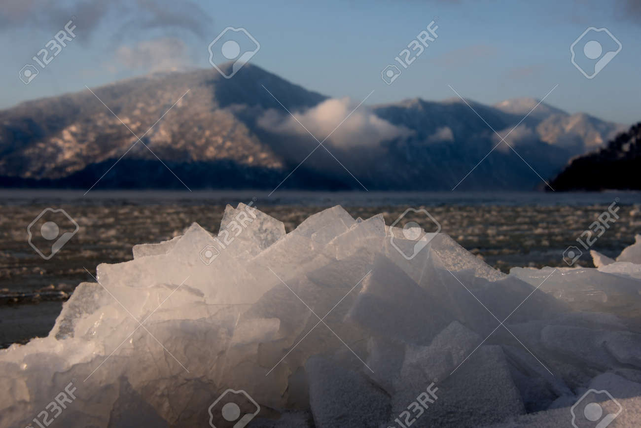 Russia. mountain Altai. Evening light in ice floods and icicles on the shore of lake Teletskoye. - 150397981