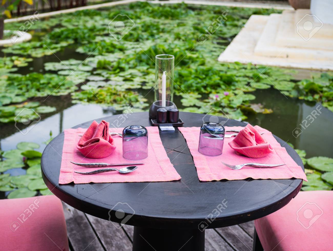 Table Setup At Restaurant With Lotus Park Stock Photo Picture And