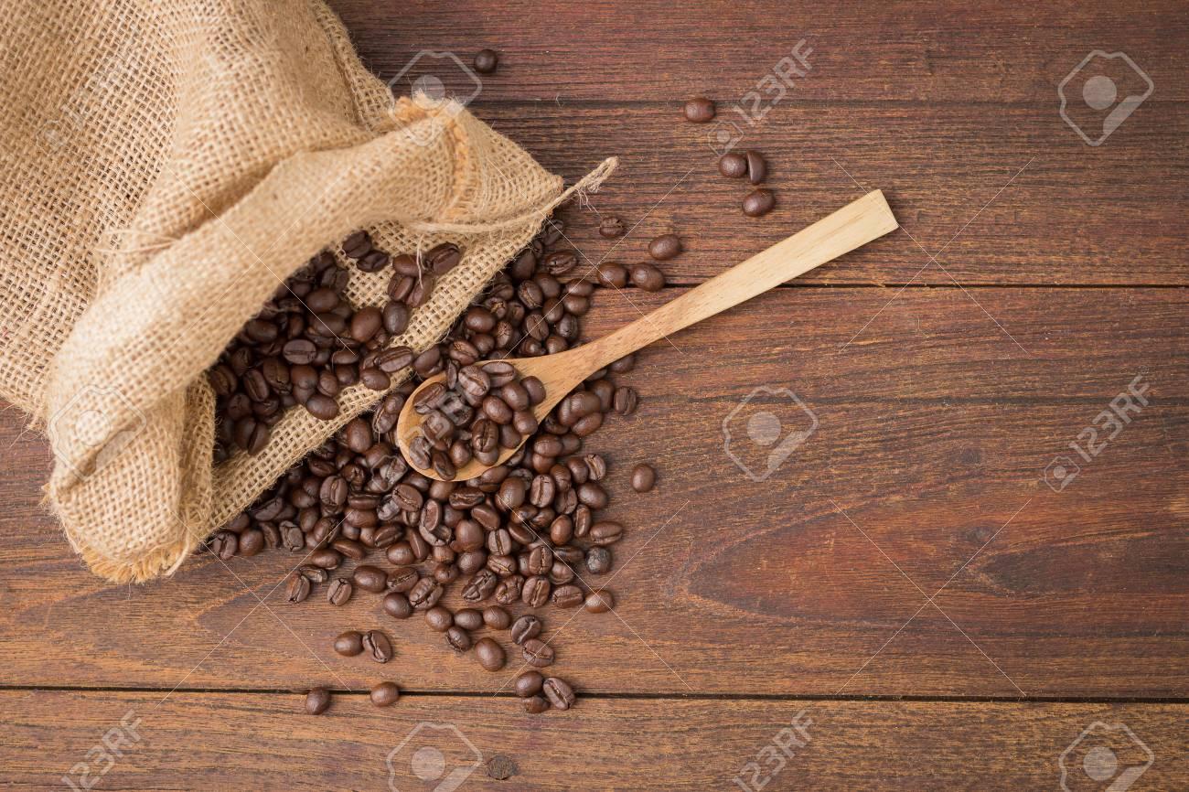 Coffee on grunge wooden background. - 73711539