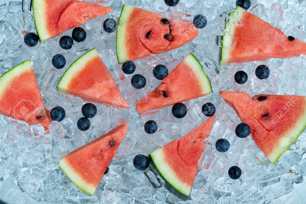 Stock Photo Watermelon Sliced And Blueberries On Ice Tube Background