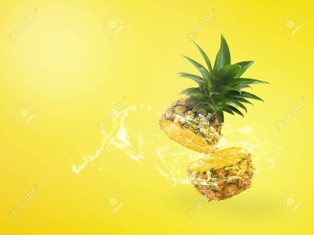 Water Splashing on Fresh Pineapple is tropical fruit isolated over yellow background. - 123203251