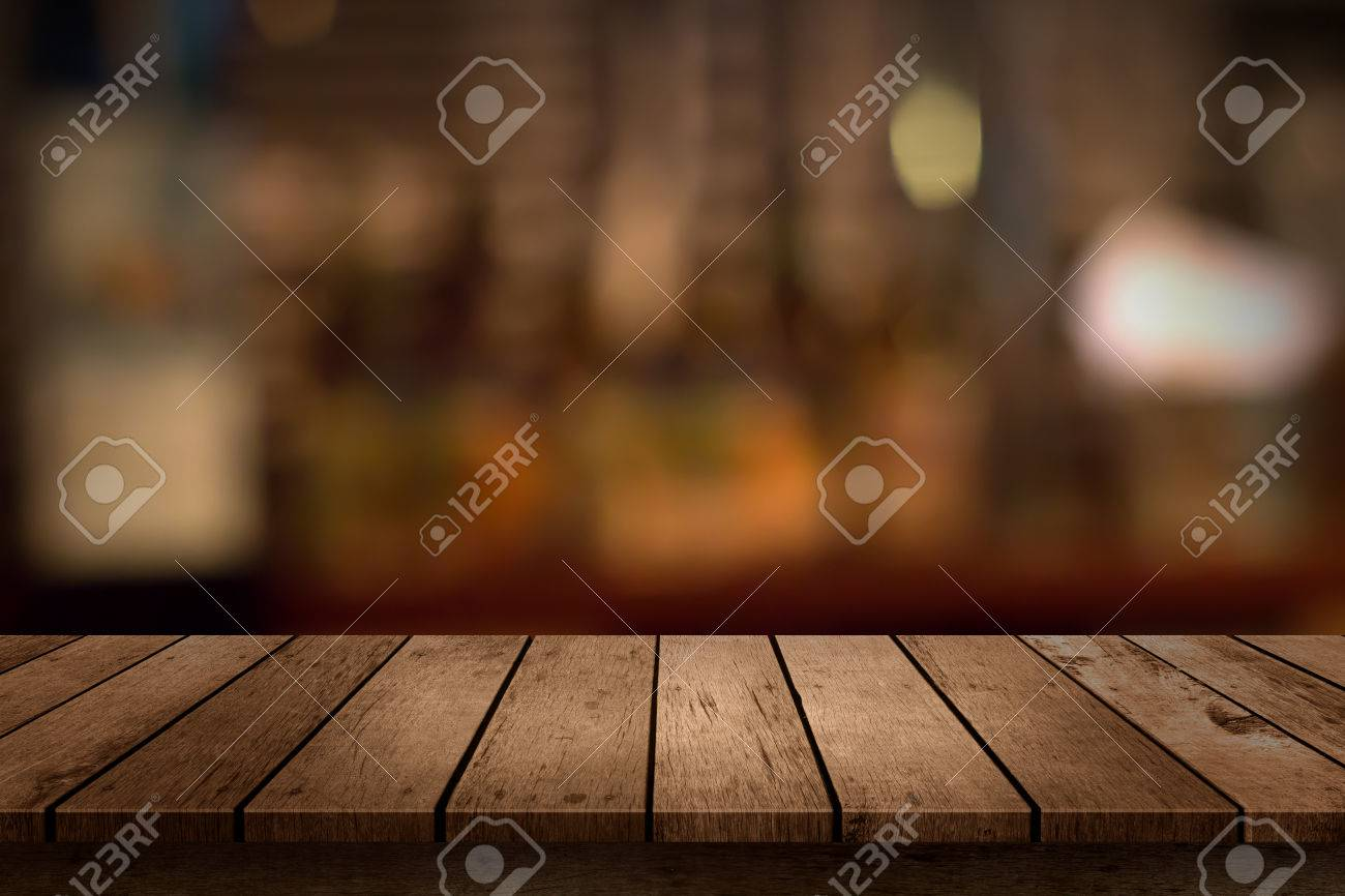 Plain wood table with hipster brick wall background stock photo - Wood Table Perspective Wooden Table With A View Of Blurred Beverages Bar Backdrop