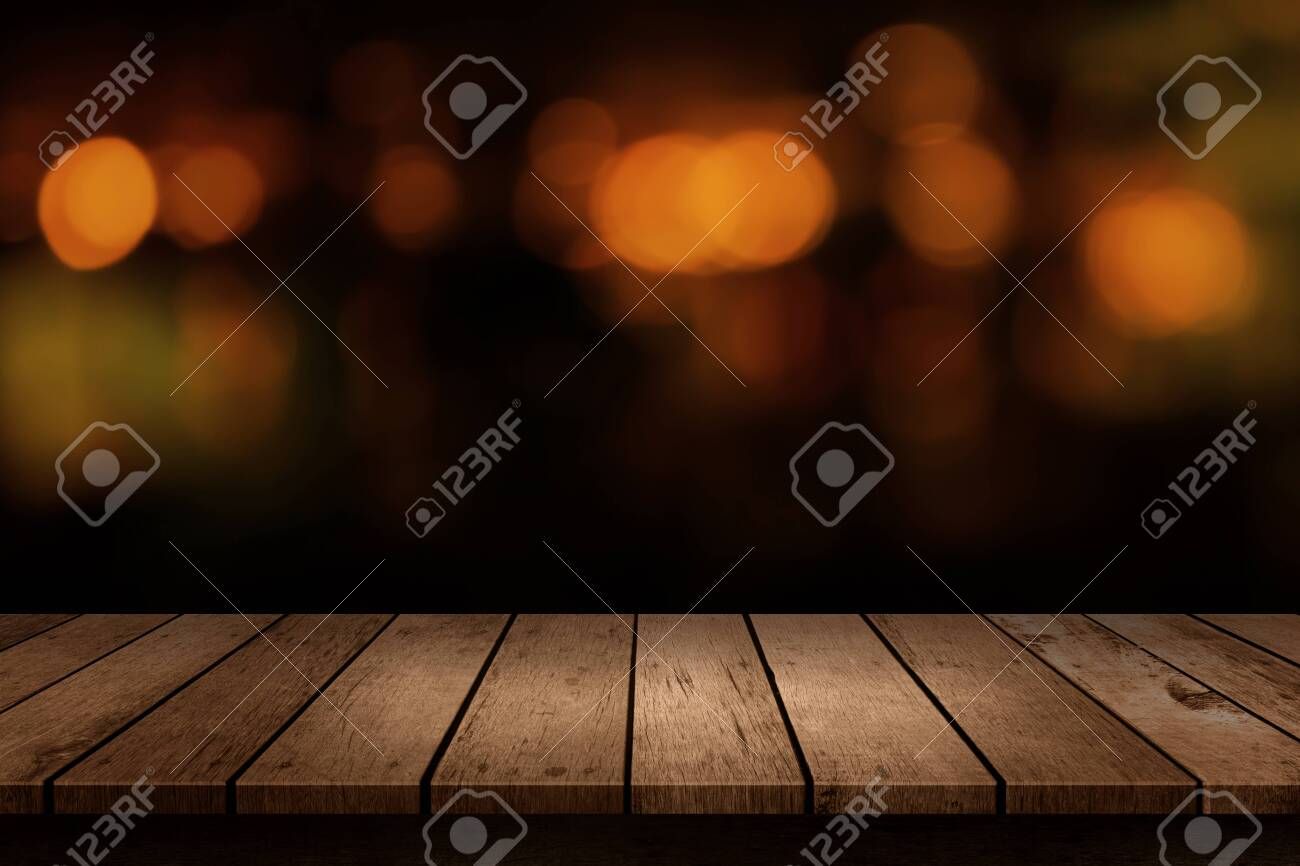 Wooden table with a view of blurred beverages bar backdrop. Blur cafe and restaurant with abstract bokeh light background. For create montage product display - 133197372