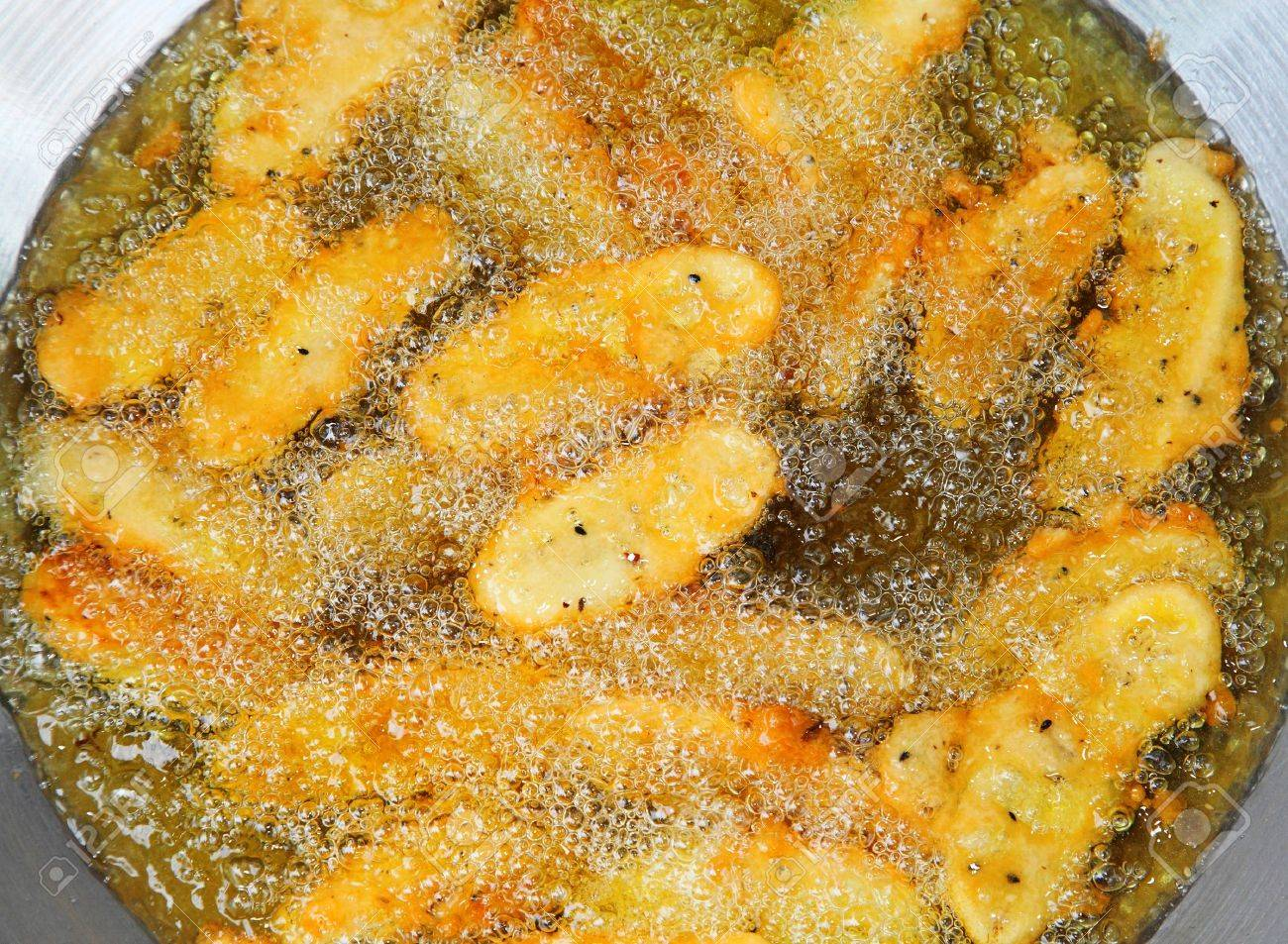 Frying Banana in the pan called Kruay Tod , the favorite dessert in Thailand - 14019113