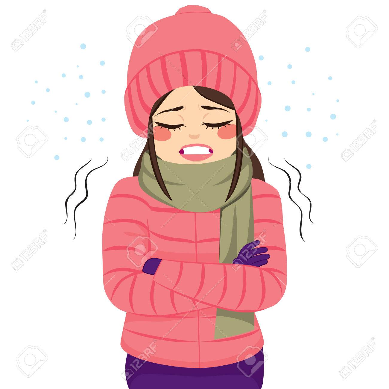 Young woman freezing wearing winter clothes shivering - 70666887