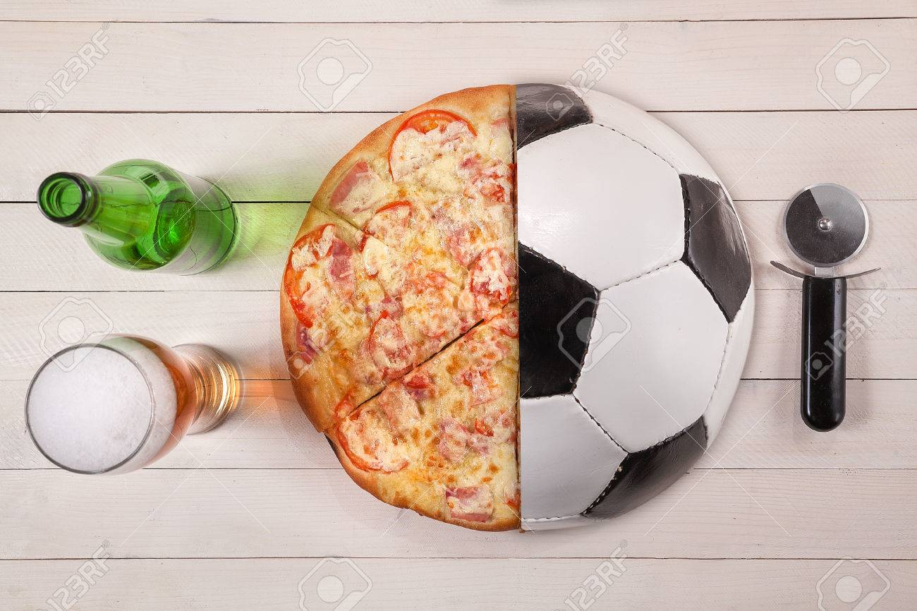 Top view of half soccer ball and pizza beer. creative con idea. - 64014168