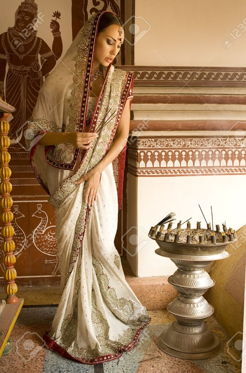 0bdbc0a460 Beautiful young indian woman in traditional clothing with incense bridal  makeup and oriental jewelry. Girl