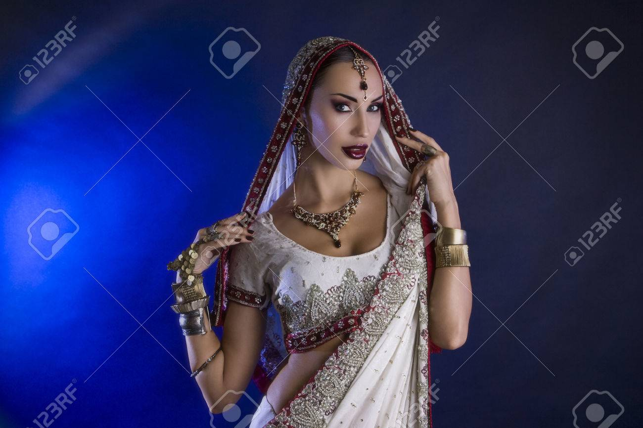 37d44c28f2 Beautiful Young Indian Woman in Traditional Clothing with Bridal Makeup and Oriental  Jewelry. Beautiful Girl