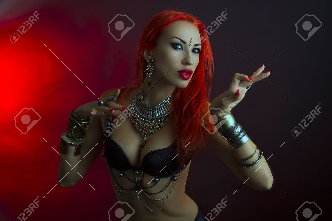 Bellydance tribal fusion beautiful redhead young woman in sexy bellydance tribal fusion beautiful redhead young woman in sexy clothing with eastern makeup and baditri Image collections