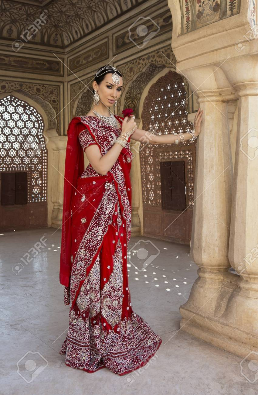 164d2969a Indian Woman in Red bridal Sari clothing with oriental jewelry. Beautiful  Indian Bride Girl in