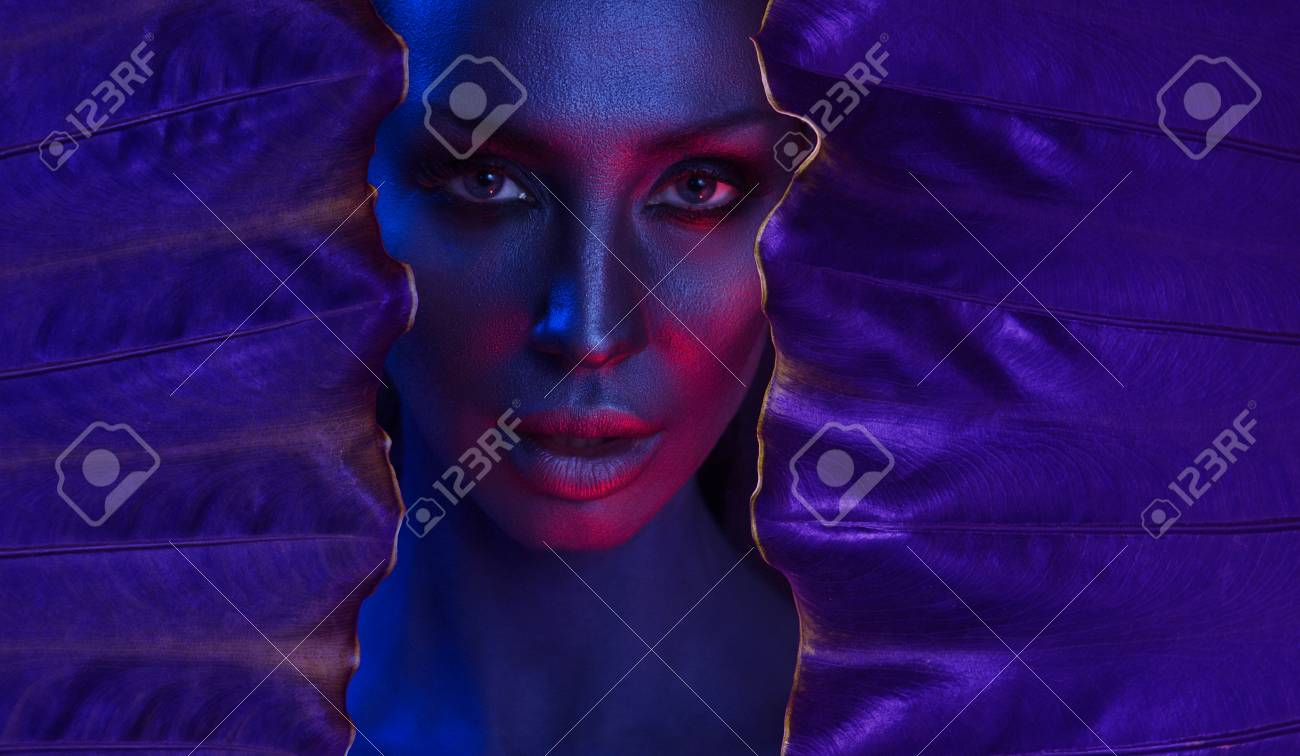 Art neon Portrait of Beautiful Young Woman with make-up  Woman's