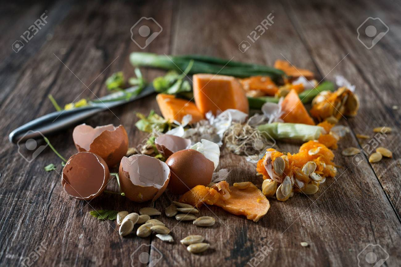 Organic leftovers, waste from vegetable ready for recycling and to compost. Collecting food leftovers for composting. Environmentally responsible behavior, ecology concept. - 61985056