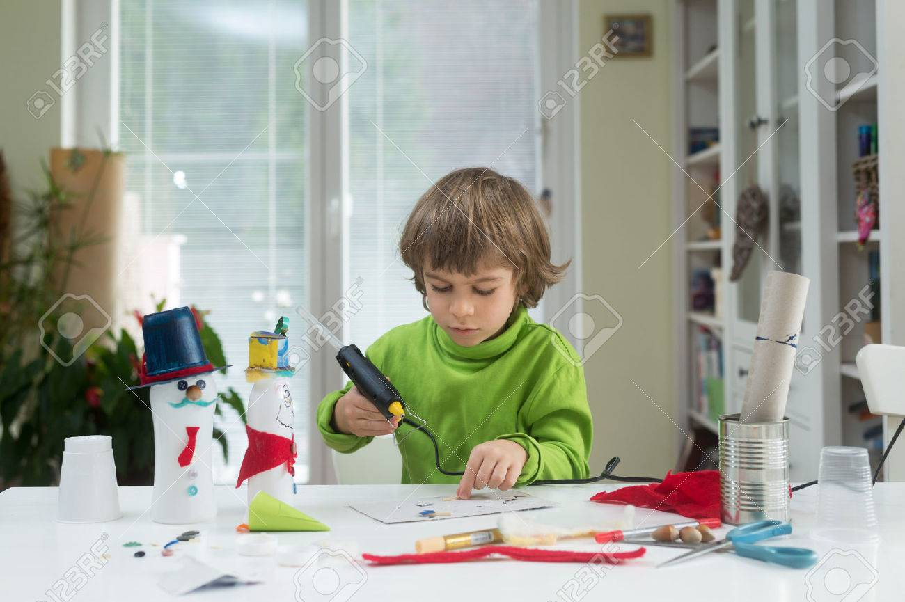 Little boy being creative making homemade do it yourself toys little boy being creative making homemade do it yourself toys out of yogurt bottle solutioingenieria Image collections