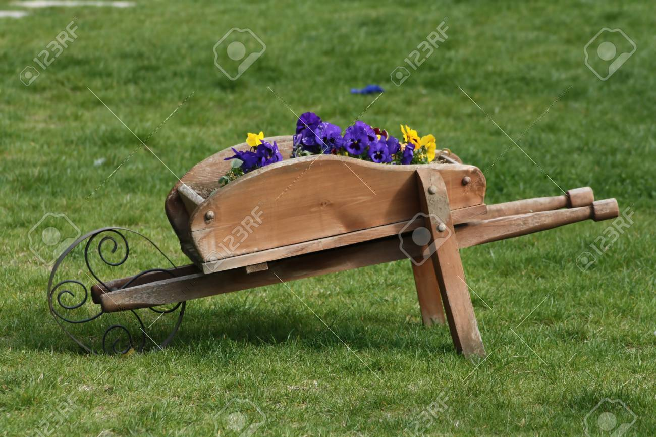 Decorative Wooden Cart On The Green Grass Stock Photo, Picture And ...