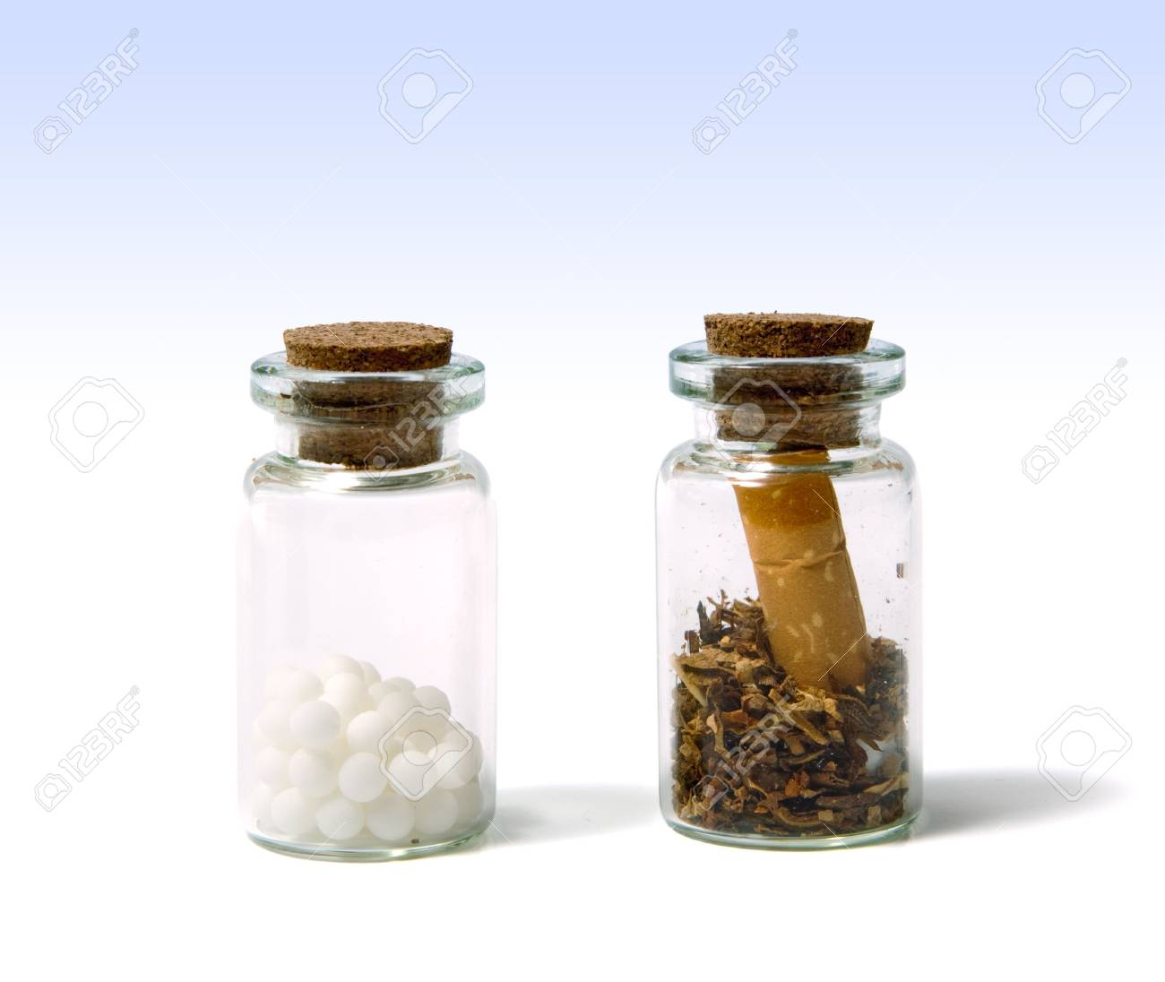 Poisons locked in bottles: cigarette butt and medications Stock Photo - 8358780