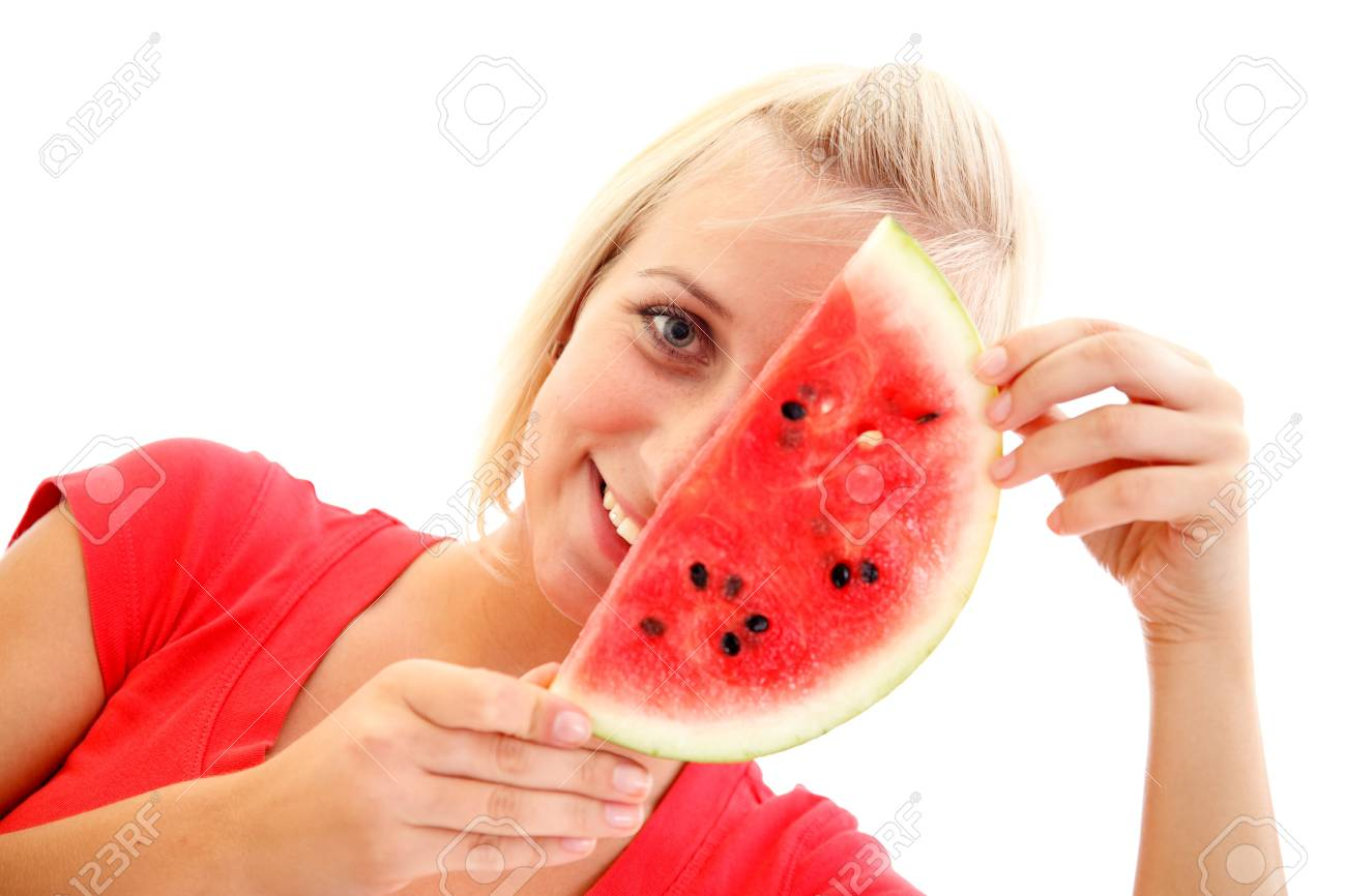 An attractive young girl eating a slice of watermelon Stock Photo - 8479969