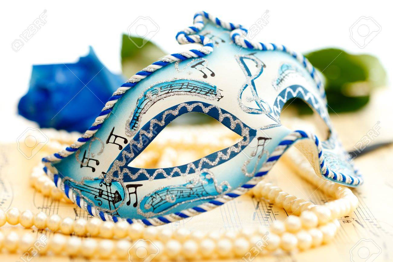 Blue and white carnival mask on a music paper with blue rose on the background Stock Photo - 9492759
