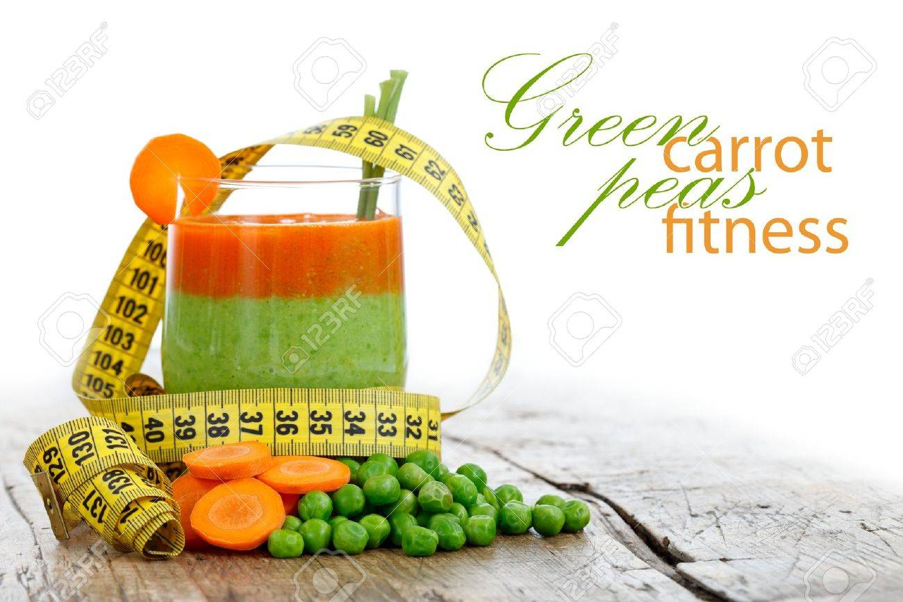 Fresh carrot and pea smoothie with measure tape, diet concept with place for your text on the right Stock Photo - 9864150
