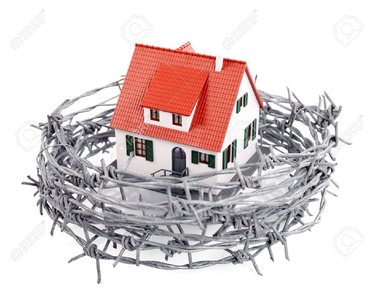 Protection Of A Miniature House With A Barbed Wire, Concept Stock ...