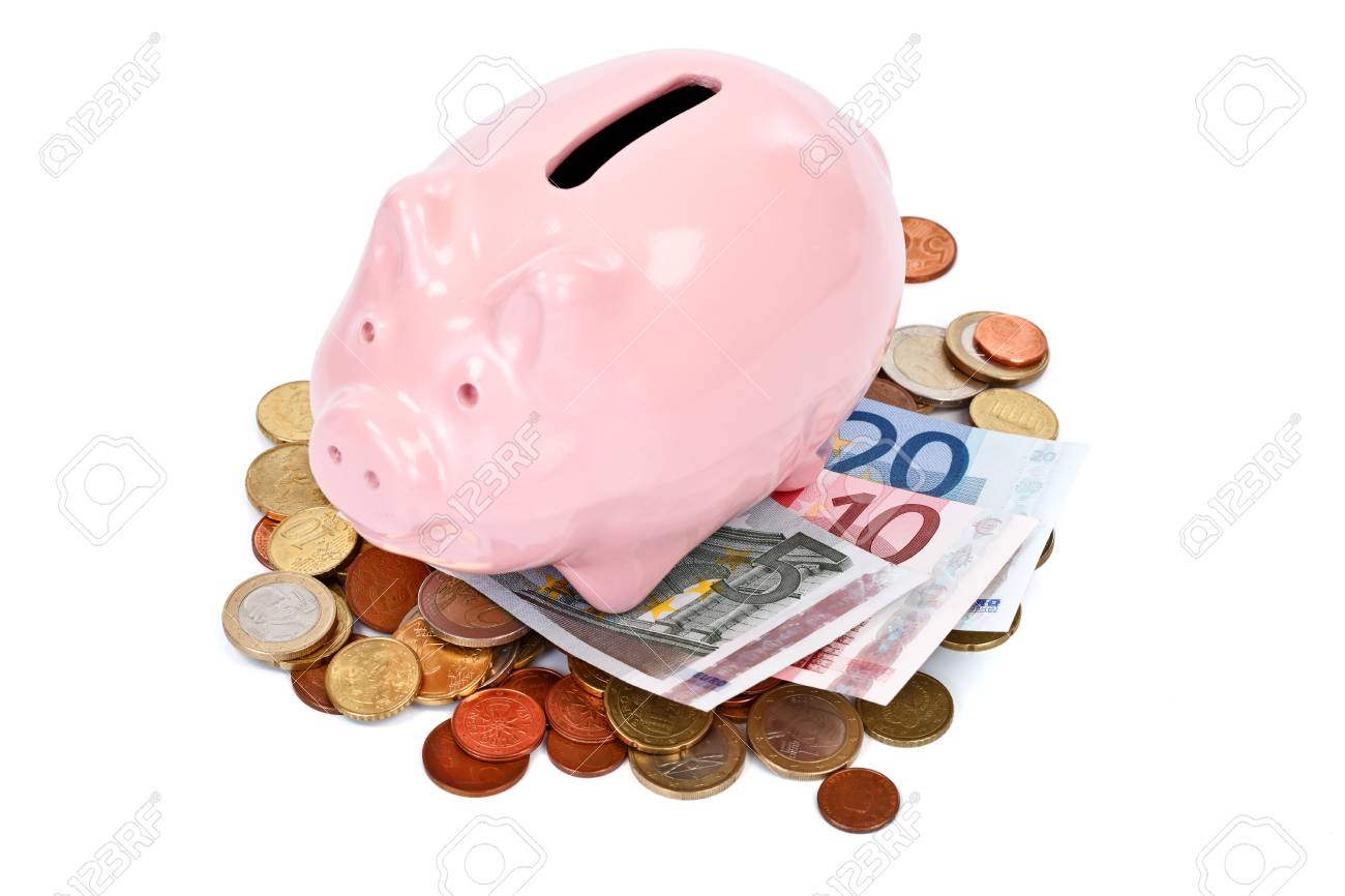 Piggy bank with money over white background Stock Photo - 10997822