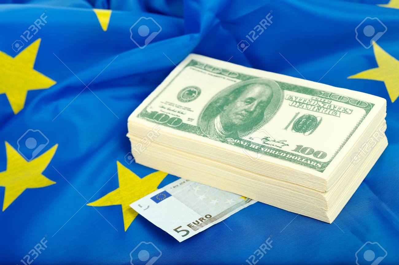 A heap of US dollars with euro on the flag of the EU Stock Photo - 12906213