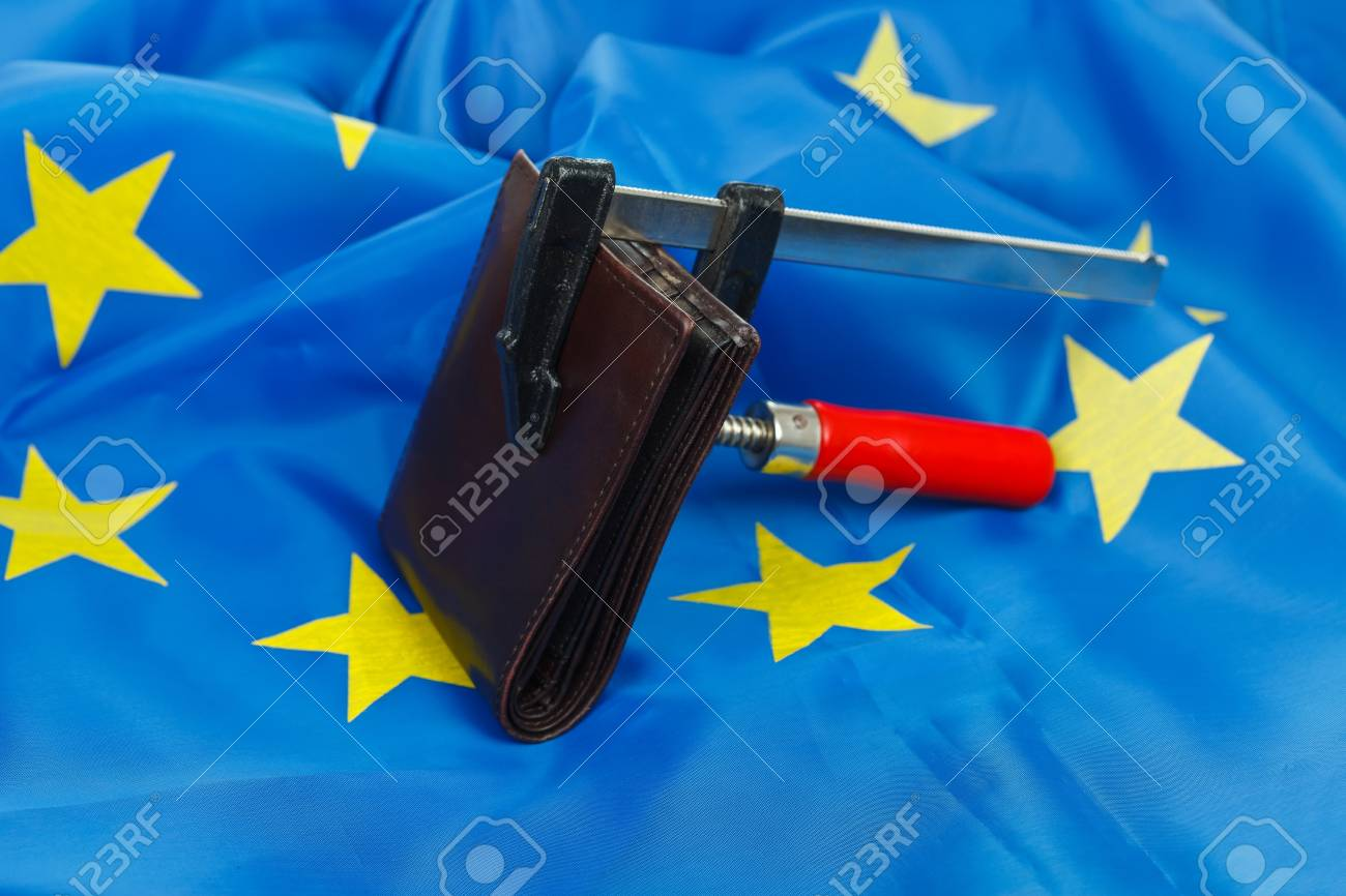 Wallet beeing squeezed in a vise, EU flag background Stock Photo - 12912327