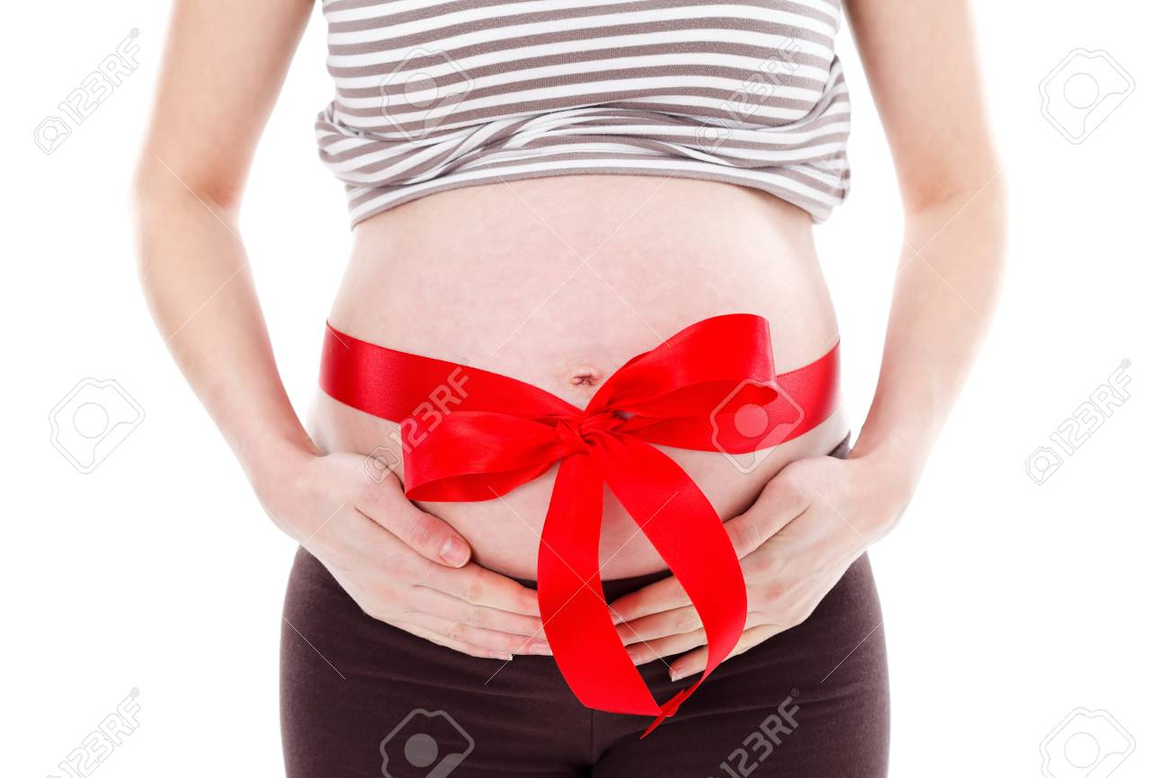 Belly of a pregnant woman with red ribbon on it Stock Photo - 12904836