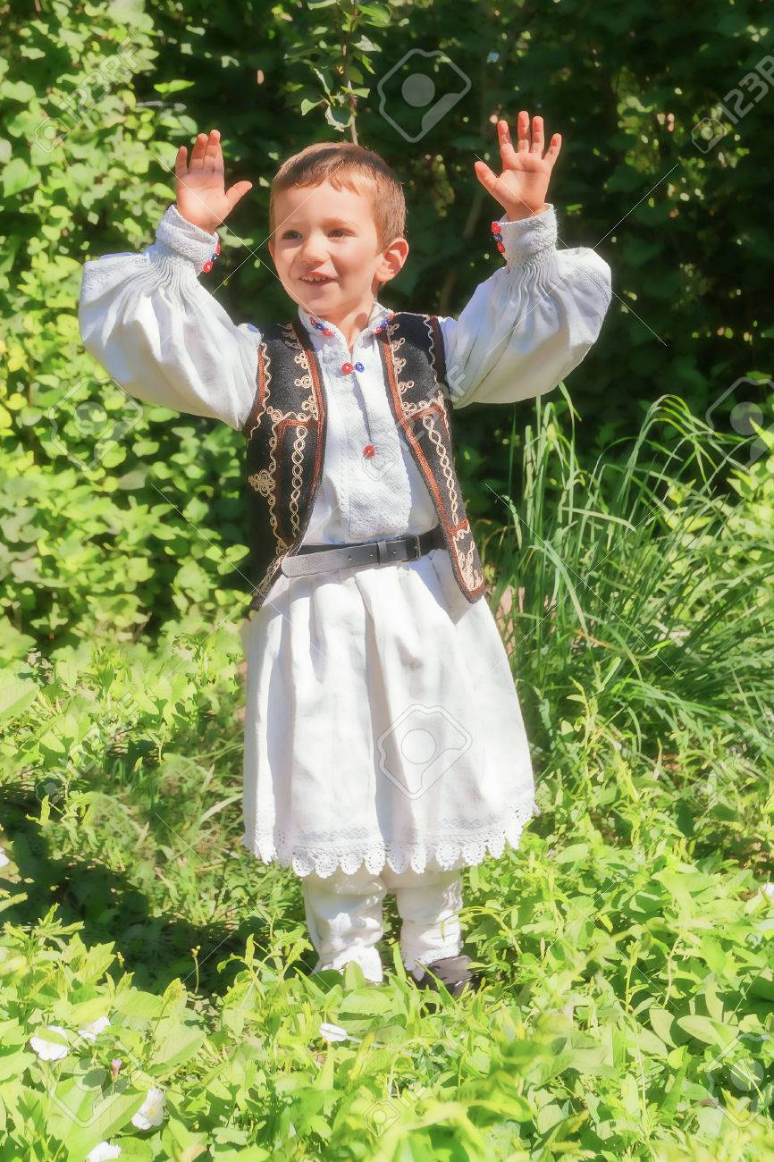 Romanian Peasant Child Dressed In A Traditional Costume Dancing
