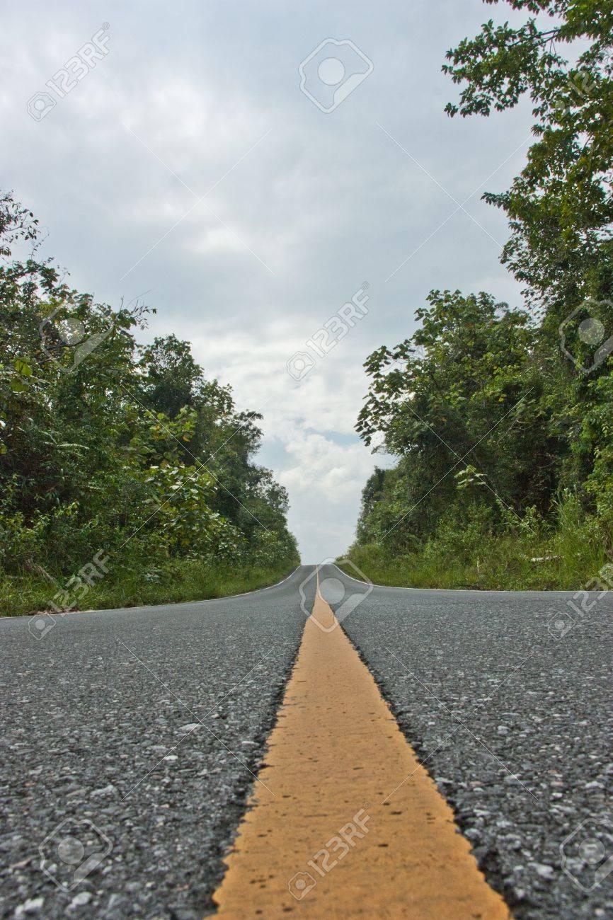 Roads, The road, asphalt, black, cars, high hills., lanes, long road, outdoor, paved, signs - 11110302
